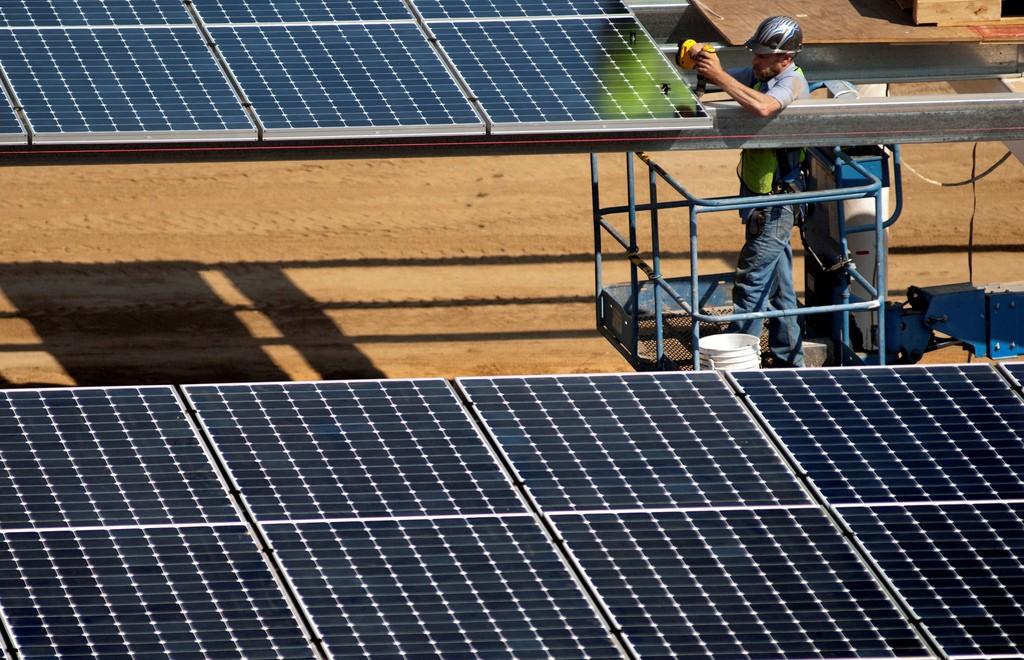 Installing solar panels at West Village, UC Davis